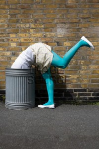 Woman looking in a dustbin